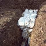 Protection of the sheets and separation of layers in landfills